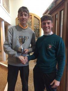 Junior Captain Harrison Leaver presenting the Junior Fernihough trophy to winner Ben Lazenby.